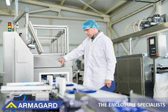 A man using a food manufacturing digital display.
