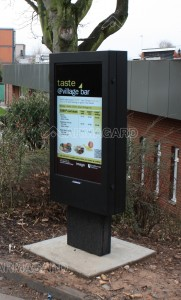 Outdoor advertising totem enclosure on a university campus