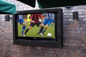 outdoor tv enclosure used in a pub beer garden