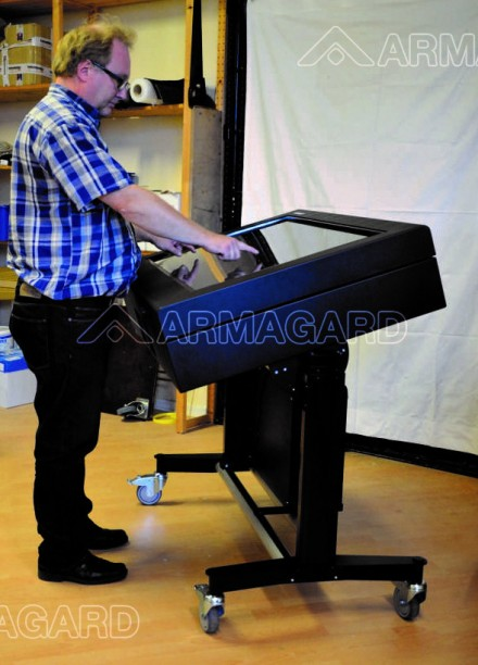 A man operating a Touchscreen LCD enclosure | Armagard 2012
