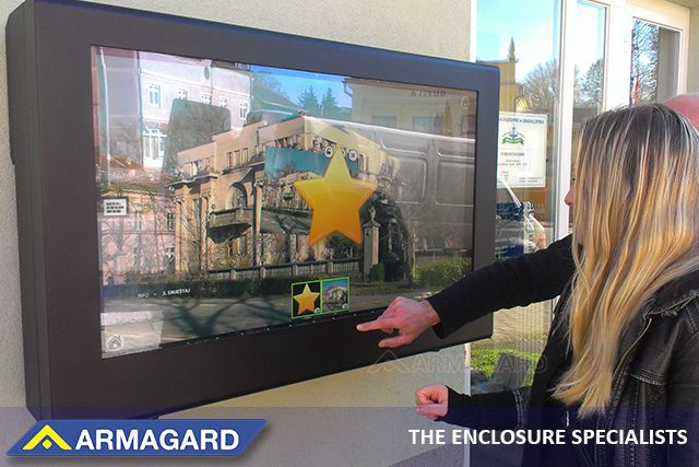Outdoor touch screen digital signage outside a business